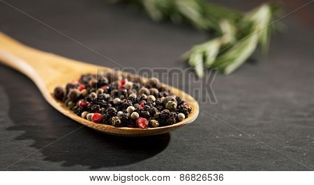 Pepper Wooden Spoon on Black Background
