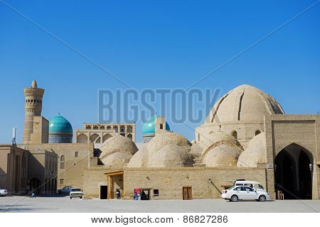 BUKHARA, UZBEKISTAN - MARCH 14, 2015: Inside of Mosque Kalon and Kalon minaret, Mir-i Arab Madrasah, Historic center of Bukhara, Uzbekistan (UNESCO World Heritage)
