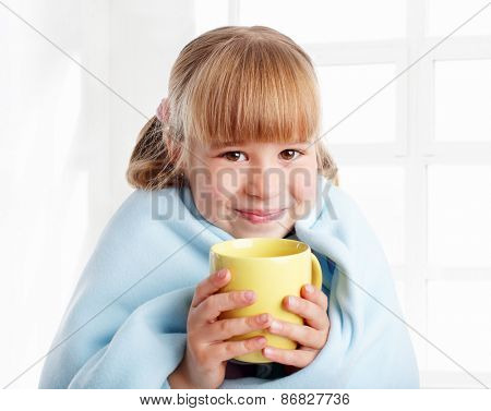 Child is ill with cup at home