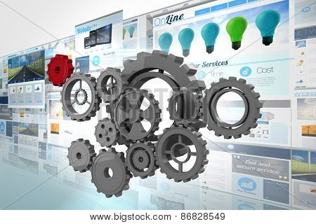Cogs and wheels against screen collage showing business advertisement