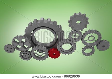 Cogs and wheels against green vignette