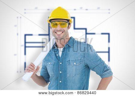 Architect holding rolled blueprint against blueprint