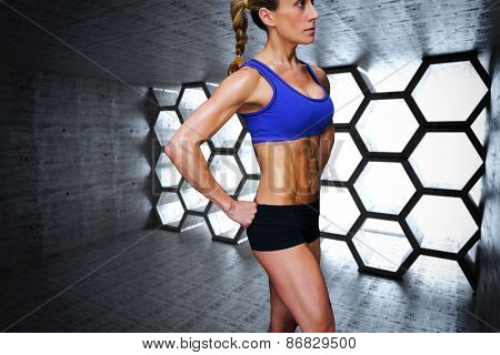 Female bodybuilder against hexagon room