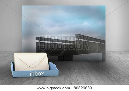 Blue inbox against room with futuristic picture of bridge