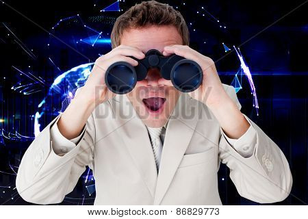 Positive businessman using binoculars against global technology background in purple