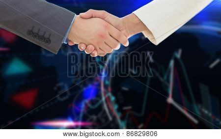 Shaking hands over eye glasses and diary after business meeting against stocks and shares