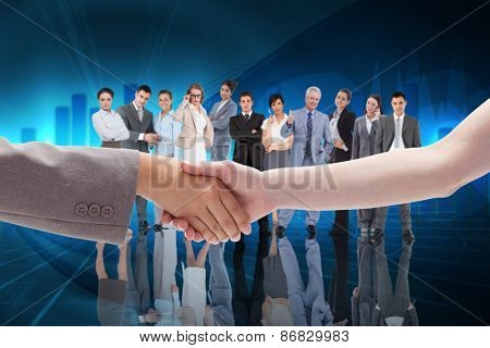 Handshake between two women against blue bar chart graphic with light