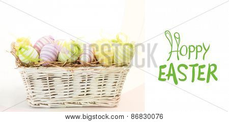 happy easter graphic against many easter eggs in basket