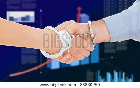 Handcuffed business people shaking hands against business interface with graphs and data