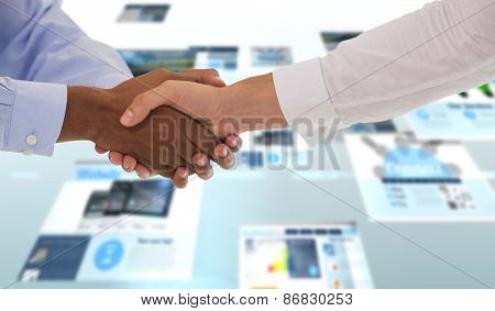 Close-up shot of a handshake in office against screen collage showing business advertisement