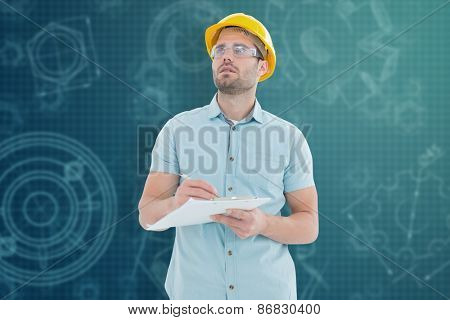 Supervisor looking away while writing on clipboard against architecture themed background
