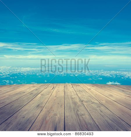 Mid air aerial view from wooden platform, sunrise with blue sky white cloud.