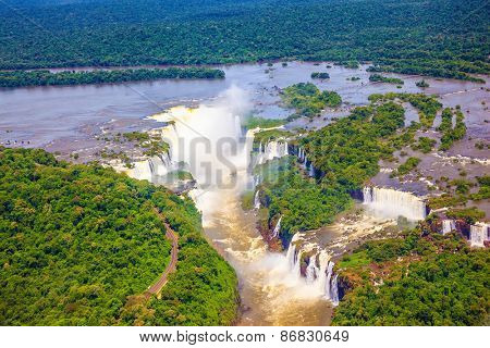 Iguazu River spreads widely among the dense tropical forests. Devil's Throat - largest waterfall of the Iguazu Falls. Picture taken from a helicopter