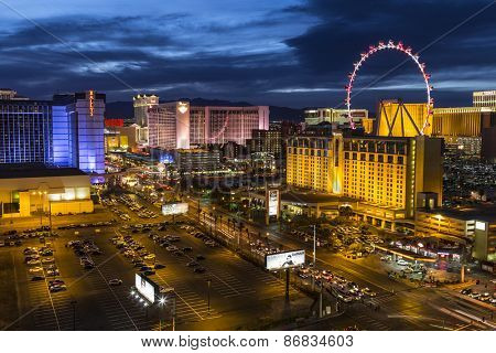 LAS VEGAS, NEVADA, USA - March 22, 2015:  Twilight at Las Vegas strip resorts and High Roller Ferris Wheel.