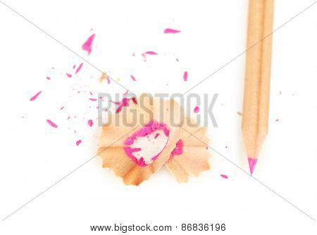 Wooden color pencil with sharpening shavings, isolated on white