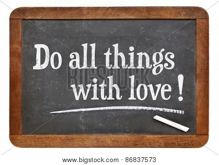 Do all things with love - positive words on a vintage slate blackboard