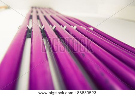 purple plastic pipes of underfloor heating system