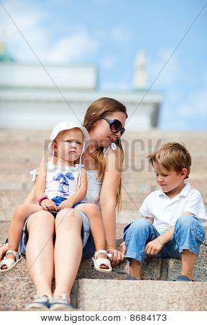 Family Enjoying Summer Day Out In City