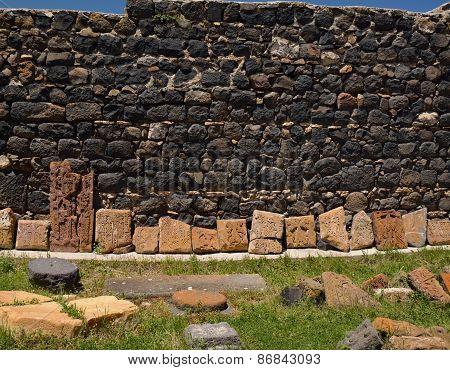 Row Of Broken Khachkars Next To The Wall, Sevanavank