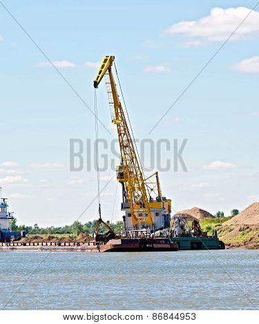 Crane river with barge