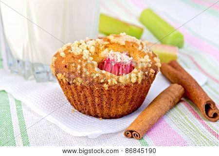 Cupcake with rhubarb and milk on linen napkin