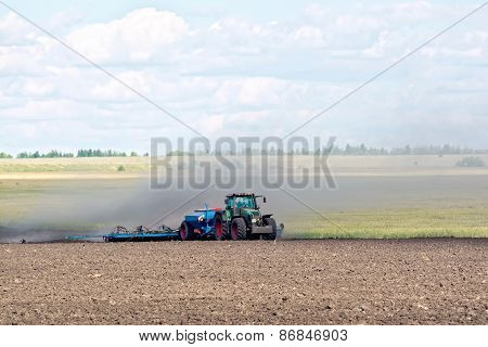 Tractor working on arable land