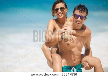 The couple are spending their honeymoon on a tropical beach.