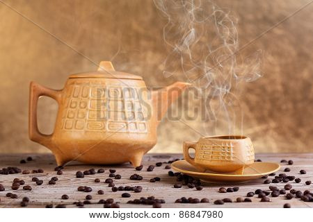 Steaming Coffee On Wooden Table