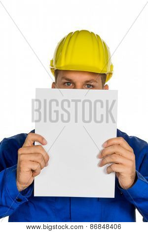 a handyman holding a blank sheet in hand