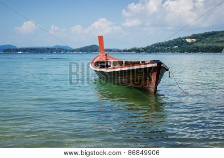 Thai Wooden Boat On A Calm Sea
