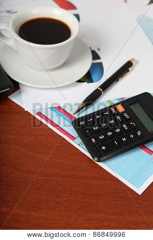 Calculator And Cup Of Coffee