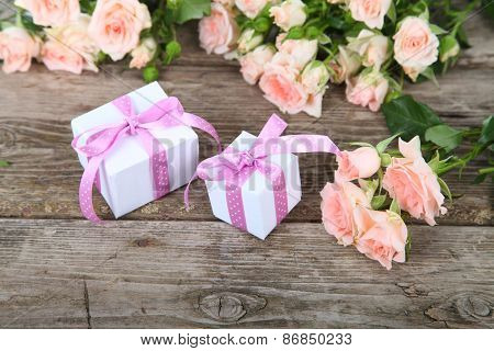 Beautiful Pink Roses And Gift In A White Box