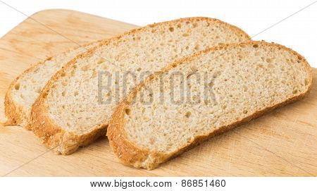 Slices Of Bran Bread On Wooden Board