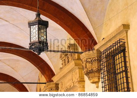 Ancient Lantern In The Courtyard Of The Palazzo Comunale In Bologna. Italy