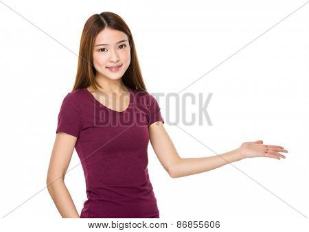 Beautiful young woman presenting your product
