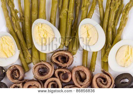 Asparagus salad with anchovies as haute cuisine.