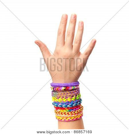 Child Hand With Colorful Rubber Rainbow Loom Bracelets Isolated