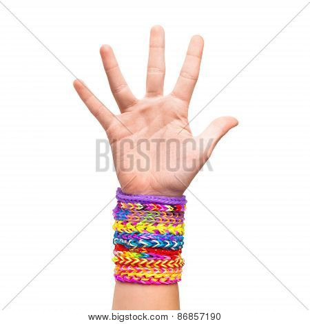 Hand With Colorful Rubber Rainbow Loom Bracelets Isolated