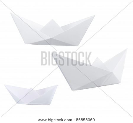 Three paper boats isolated over white