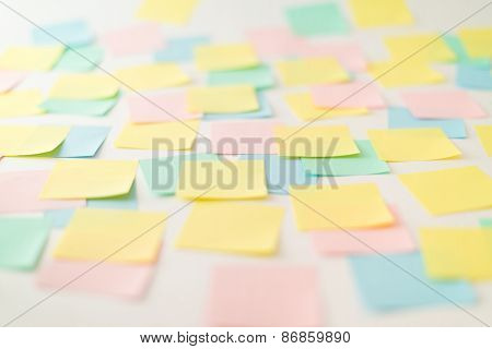 Multicolored paper stickers on wall