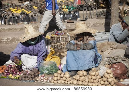 ADDIS ABABA, ETHIOPIA-OCTOBER 31, 2014: Unidentified women sell vegetables at a stree market in Addis Ababa, Ethiopia