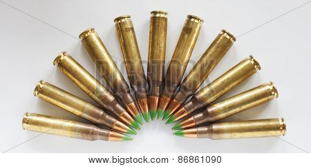 Ring Of Green Tipped Cartridges On White