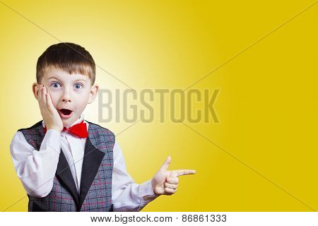 Pointing with finger Excited, Surprised little boy