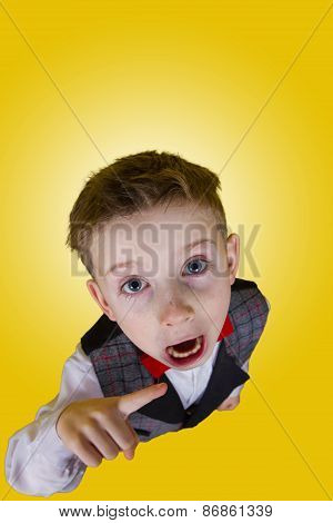 Furious little boy pointing to camera