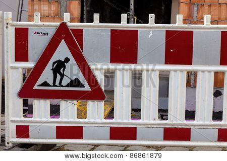 protection of the road at a construction site. sign with construction worker
