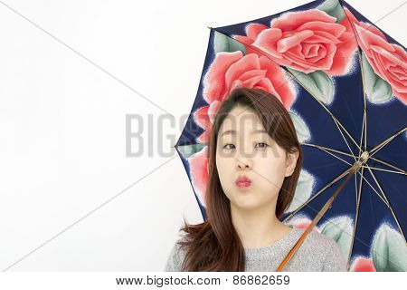 Beautiful asian woman with an umbrella