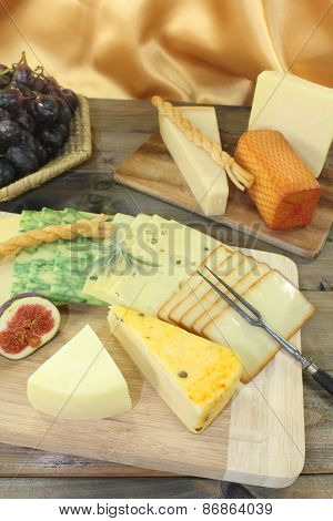 Slices Of Cheese With Grapes And Figs