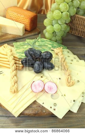 Slices Of Cheese With Grapes And Radisches
