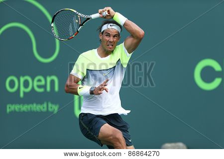 KEY BISCAYNE, FL-MAR 27: Rafael Nadal of Spain returns a shot during day five of the Miami Open at Crandon Park Tennis Center on March 27, 2015 in Key Biscayne, Florida.