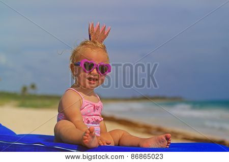 cute little baby princess on summer beach